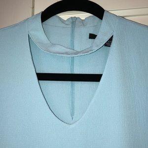 Sleeveless pale blue top